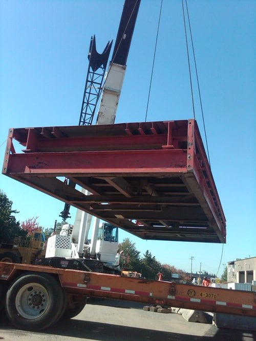 Industrial scale being lifted off truck